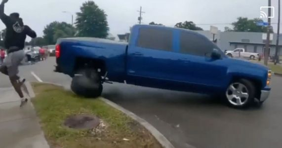 Chevrolet Silverado Gets Intimately Acquainted With The Kerb While Leaving Car Meet